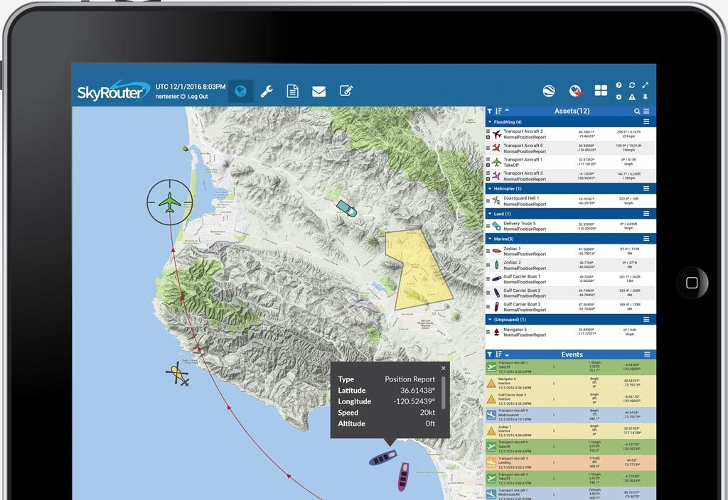 ipad with a map on the screen. Airplane, helicopter, truck and boats are being tracked.